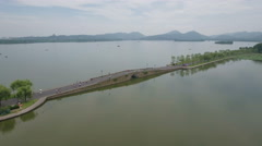 Aerial drone flight over traditional bridge at West Lake Hangzhou Stock Footage