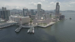 Aerial drone view of Star Ferry Pier and Kowloon skyline Hong Kong Stock Footage
