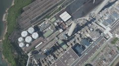 Overhead aerial drone shot of massive coal fired power station in Hong Kong Stock Footage