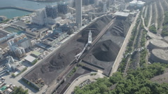 Aerial drone flight towards a pile of coal used for a power plant in Hong Kong Stock Footage