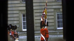 1969: uniform men lining up in formation as onlookers watch from beyond a fence Stock Footage