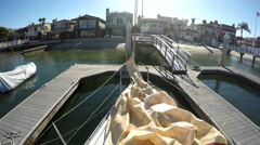 Jib on desk of racing yacht at dock with golden sunshine. Stock Footage