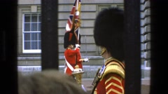 1969: a crowd watching uniformed guards lined up beyond a fence IRELAND Stock Footage