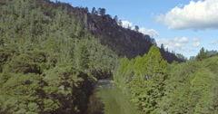 Aerial over river,  forest and mountains in the Coromandel, New Zealand Stock Footage