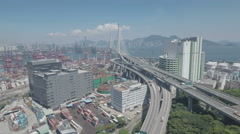 Panoramic aerial view of cargo terminal industrial zone bridge Hong Kong Stock Footage