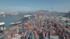 Aerial drone flight over container terminal at Port of Hong Kong Stock Footage