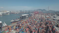 China economy, drone flight container terminal, Hong Kong skyline harbor Stock Footage