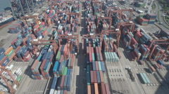 Overhead aerial footage flying over container terminal Hong Kong Stock Footage