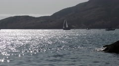 Sailboat leaving Two Harbors Catalina in the late afternoon view is from bobb Stock Footage