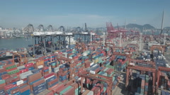 Flying backwards over amazing container terminal in Hong Kong city Stock Footage