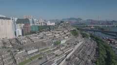 Flying over a large graveyard located on a steep hill in Hong Kong Stock Footage