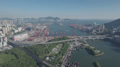 High angle aerial shot of Port of Hong Kong and skyline Stock Footage