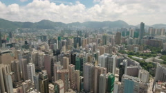 Aerial shot flying over residential flats and office towers Hong Kong Stock Footage