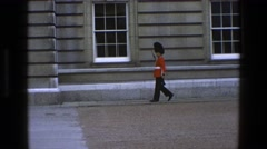 1969: serious royal guard protecting the queen but still funny to tourists Stock Footage