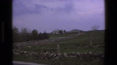 1969: winding road up the side of the hill with a stone fence lining either side Stock Footage