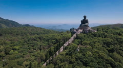 Religion in Asia, beautiful drone flight over large Buddha statue Hong Kong Stock Footage