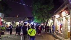 Fashion young people roam along Nanluogu Alley at night, Beijing, China Stock Footage