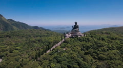 Aerial drone flight over peaceful Buddha statue in Hong Kong Asia Stock Footage