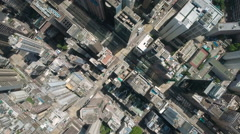 Overhead aerial flight over grid structure urban landscape Hong Kong China Stock Footage