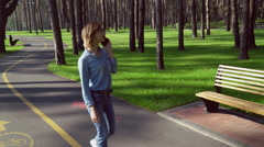 Businesswoman call her partner outdoors use internet Stock Footage