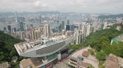 Flying over the Victoria Peak viewing platform to spectacular Hong Kong skyline Stock Footage