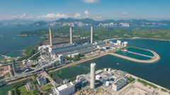 Flying to industrial gas coal fired power station on Lamma Island Hong Kong Stock Footage