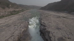 Retreating aerial shot of impressive Hukou Waterfalls on Yellow River China Stock Footage