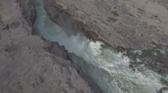 Rotating aerial footage of the Hukou waterfalls, Yellow River in central China Stock Footage