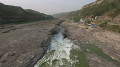 Tilting aerial footage beautiful Hukou waterfall, Yellow River China Stock Footage