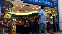 One side of people shopping inside sweet factory store with 4k resolution Stock Footage