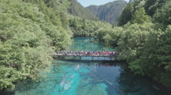 Aerial view crowds of tourists visiting Jiuzhaigou national park in China Asia Stock Footage