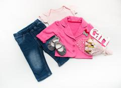 Set of baby girl clothes on holiday. Stock Photos