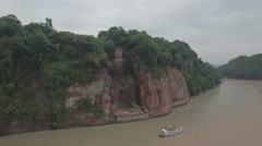 Flying towards the massive giant Buddha statue in Leshan, China Stock Footage