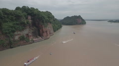 Aerial view of giant Buddha statue, carved into cliff formation in Leshan China Stock Footage