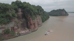 Aerial drone shot of the giant Buddha statue in Leshan, China Stock Footage