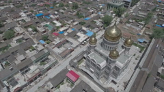 Aerial panning video of golden domed mosque in Linxia, China Stock Footage