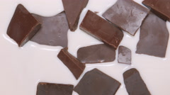 TOP VIEW: Milk fills a chocolate pieces Stock Footage
