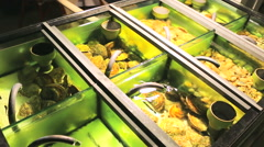 Clams in the aquarium of seafood restaurant Stock Footage