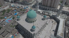 Slow aerial pan of a green domed mosque in China Stock Footage