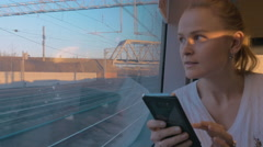 In Saint-Petersburg, Russia in train rides young girl and looking out the window Stock Footage