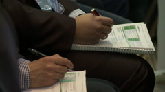 Business conference. Men make notes in manual Stock Footage