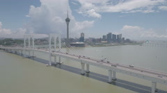 Flying away from cable-stayed bridge and Macau skyline Stock Footage