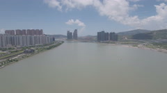 Flying over border between Macau and mainland China Stock Footage