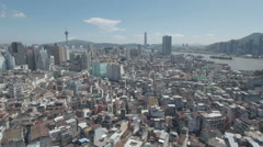 Aerial footage flying over the old center of Macau, modern skyline in background Stock Footage