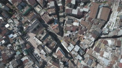 Overhead aerial drone flight over narrow streets of old town of Macau Stock Footage