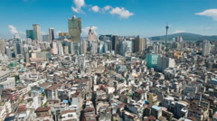 Flying over the old city center of Macau towards the famous casino buildings Stock Footage