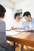 Young Japanese couple consulting with financial planner Stock Photos
