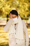 Senior Japanese man with mask feeling sick Stock Photos