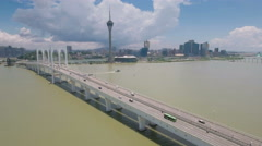 Aerial drone flight past a long cable-stayed bridge and Macau skyline Stock Footage