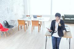 Japanese man working in modern office Stock Photos